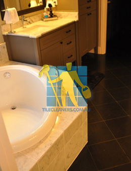 traditional bathroom with black granite tiles on the floor Molonglo Valley