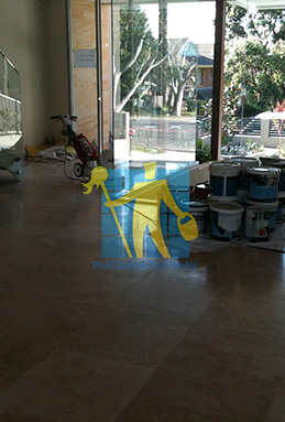 extra large porcelain floor tiles after cleaning empty room with polisher Canberra